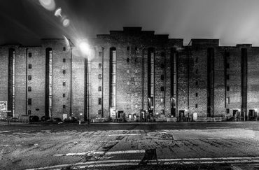 The front of Victoria Warehouse in black and white.