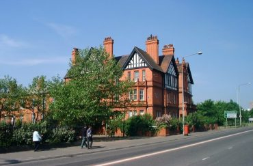 Red brick exterior of the Working Class Movement Library, fronted by trees