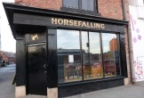 Photo of the black-painted front of the Horsefalling shop