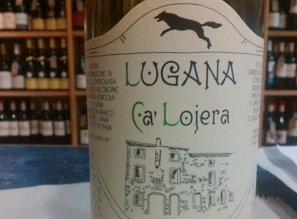 Bottle of Lugana wine with leaping wolf design