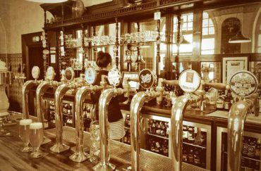 Sepia image of the bar taps in The Sheffield Tap