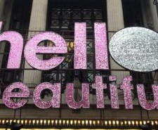 Photo of a glitter sign saying 'hello beautiful'