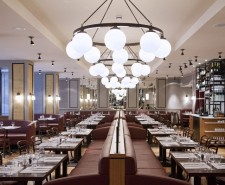 Photo of Côte's interior with Burgundy banquettes