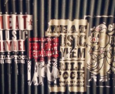Posters on corrugated iron, advertising Grillstock.