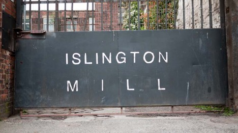 Photo of Islington Mill's sign on the gate