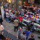 Photo of long tables and people drinking at last year's Expo