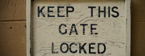 Photo of a sign that says 'Keep This Gate Locked'