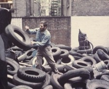 Photo of Allan Kaprow's YARD, a performance piece involving tyres.