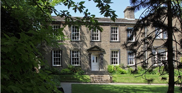 The Bronte Parsonage Museum front, with a green lawn