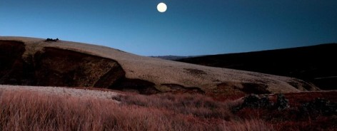 Photo of Howarth moor at night, with a full moon above it