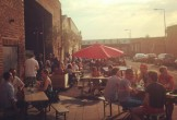 Photo of Camp and Furnace's outdoor seating in summer