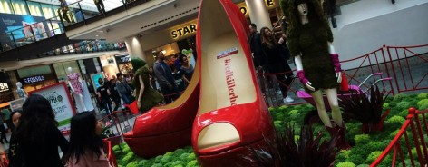 Photo of Frog Flowers' Dig the City installation at the Arndale Centre, with an enormous pair of red shoes