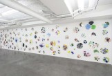 C++ by Ryan Gander, showing a wall of paint-splashed perspex palettes