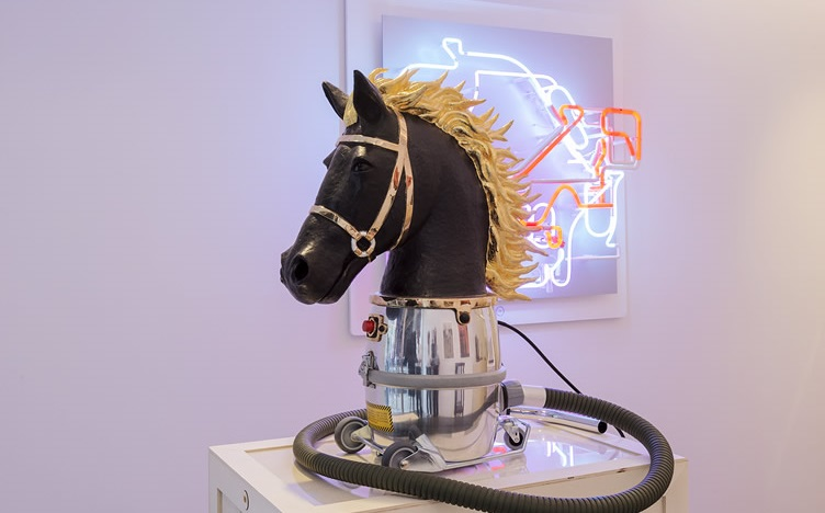Photo of a horse head and neon light