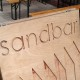 Photo of Sandbar's wooden pavement sign