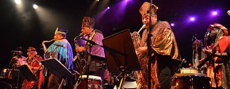 Photo of the Sun Ra Arkestra playing jazz in colourful outfits