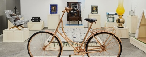 Photo of a bike and other items in a design studio