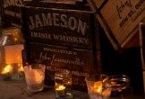 Photo of a Jameson barrel of whiskey with candles in jars
