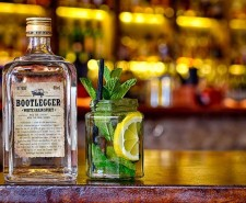 Photo of a bottle of 'Bootlegger' white grain spirit next to a jar with mint