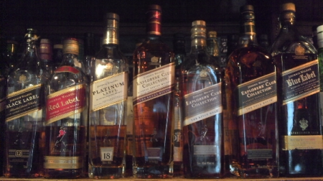 Photo of a row of whisky bottles