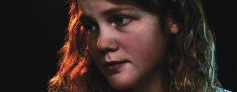 Photo of Kate Tempest, with a red light in her hair
