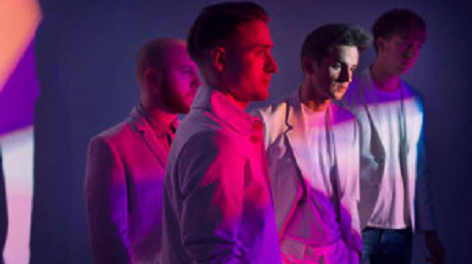 Pink and purple photo of band members from Wild Beasts