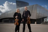 Photo of two musicians stood in front of IWM North