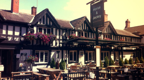 Photo of the Horse and Jockey pub with beer garden out front