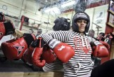 Photo of a female Muslim boxer in red gloves