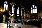 Photo of a speaker at the Design Manchester festival in the town hall