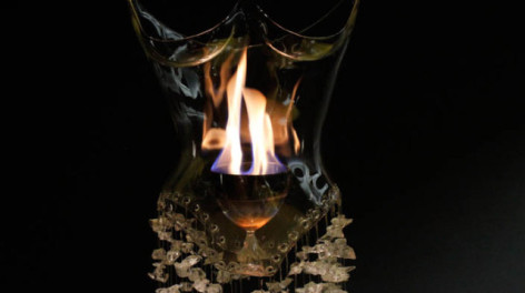 Close up image of glass dress with fire inside