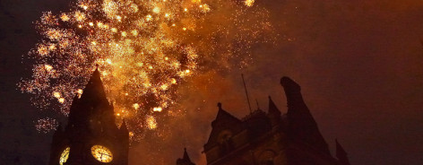 Photo of golden fireworks above the town hall clock