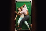 Photo from above of Othello and Desdemona on a pool table
