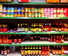 Photo of the Siam Smiles shelves, with colourful bottles of drink