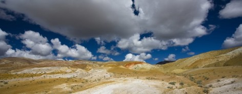 Photo of a yellowand great landscape with great clouds in a blue sky