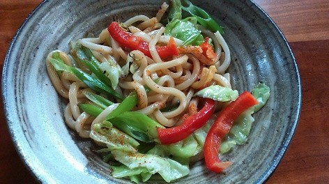 Photo of a bowl of noodles with pepper