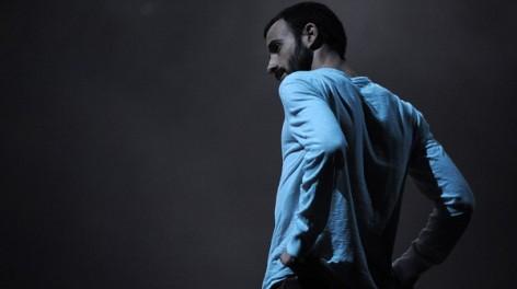 Photo of a man lit blue