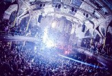 Photo of the Albert Hall purple lit with confetti cannons.