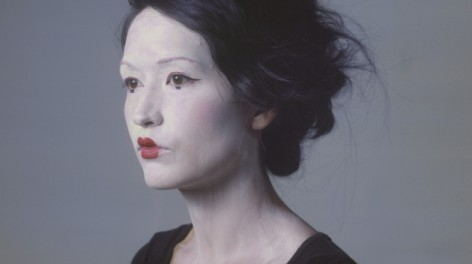 Photo of artist Naomi Kashiwagi with geisha makeup on