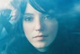 Blue tinted photo of Sharon Van Etten
