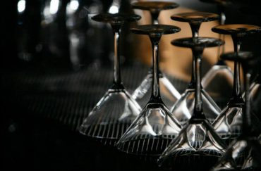 Photo of upturned cocktail glasses