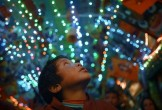 A child looks up at bright lights