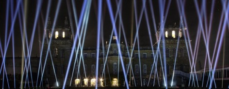 Photo of blue lasers coming from the ground