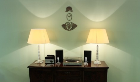 Photo of a bureau with two lampshades