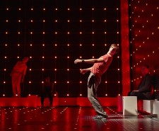 Shot of the stage with a boy in a red t-shirt leaning backwards