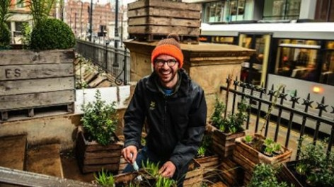 Gardener in residence Sean Harkin planting The Lost Gardens of Manchester © Clement Neveu