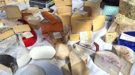 Array of cheeses on a market stall