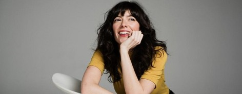 Singer Natalie Prass leaning against a chair