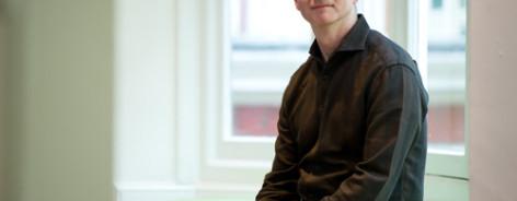 Photo of John McGrath in a black shirt