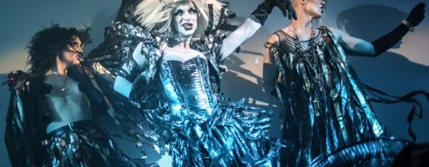 Picture of drag queens in reflective blue outfits